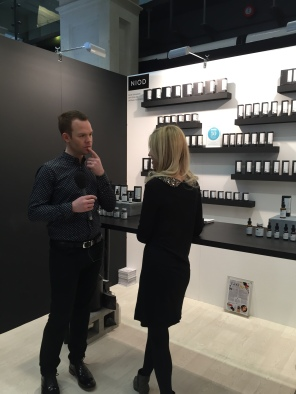 QVC presenter Will Gowing interviews Deciem Co CEO Nicola Kilner on the NIOD stand