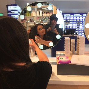 Nikki Taylor with a Selfridges Birmingham team member using OUAI Haircare