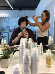 Nikki Taylor assessing OUAI Haircare & Dyson Supersonic Hairdryer training