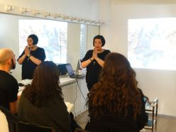 Nikki Taylor delivering training to the Laura Geller UK Pro Makeup Artist Team