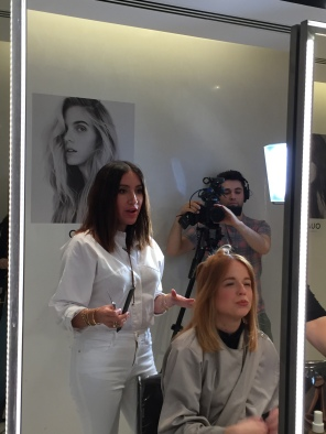 Jen Atkin styling hair at the OUAI Haircare pop-up