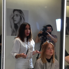 Jen Atkin styling hair at the OUAI Haircare pop-up