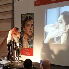 Nikki Taylor and Mark McDonald watch Vincent Longo Cosmetics Director of Style & Artistry Tiffany Kissler deliver a demo onstage at Professional Beauty