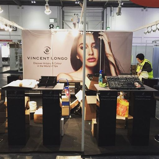 Nikki Taylor helps build the Vincent Longo Cosmetics stand at Professional Beauty