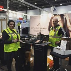 Nikki Taylor with Mark McDonald building the Vincent Longo Cosmetics stand at Professional Beauty