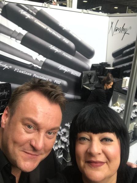 Nikki Taylor with makeup artist Paul Herrington on the Nanshy stand at IMATS