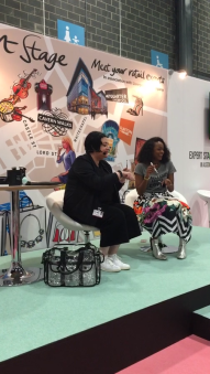 Nikki Taylor shares a laugh with presenter Annaliese Dayes on the Expert Stage