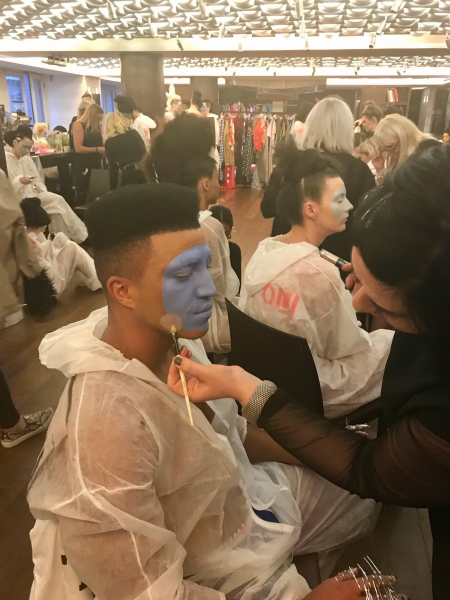 Nikki Taylor uses touchinSOL makeup on models backstage at the Vin + Omi London Fashion Week SS18 showcase