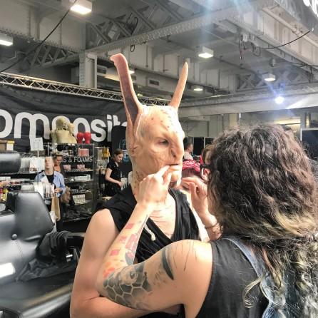 Nikki Taylor watches a character being created at IMATS