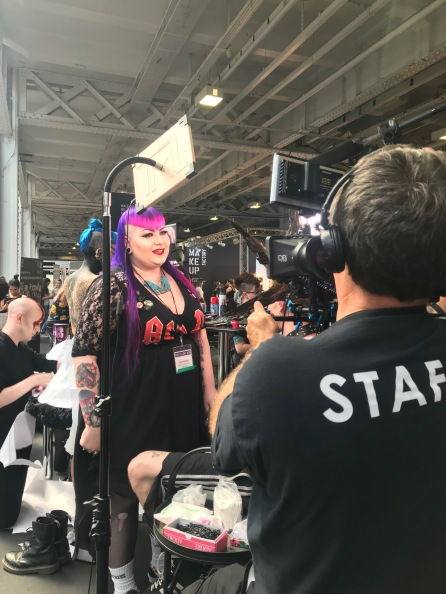Nikki Taylor watches makeup artist Emily Clayton (AKA Vanity Venom) at work at IMATS