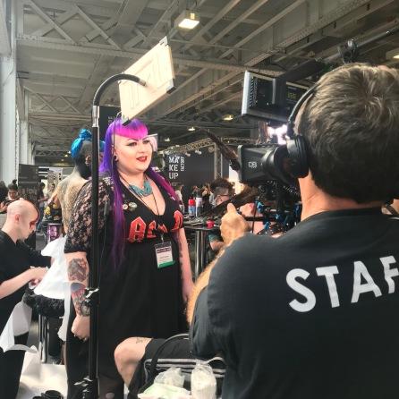 Nikki Taylor watches makeup artist Emily Clayton (AKA Vanity Venom) at work at IMATS