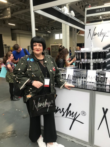 Nikki Taylor visits the Nanshy booth at IMATS