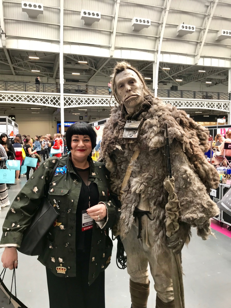 Nikki Taylor with a creature created by Academy Award-winner Lucy Sibbick at IMATS